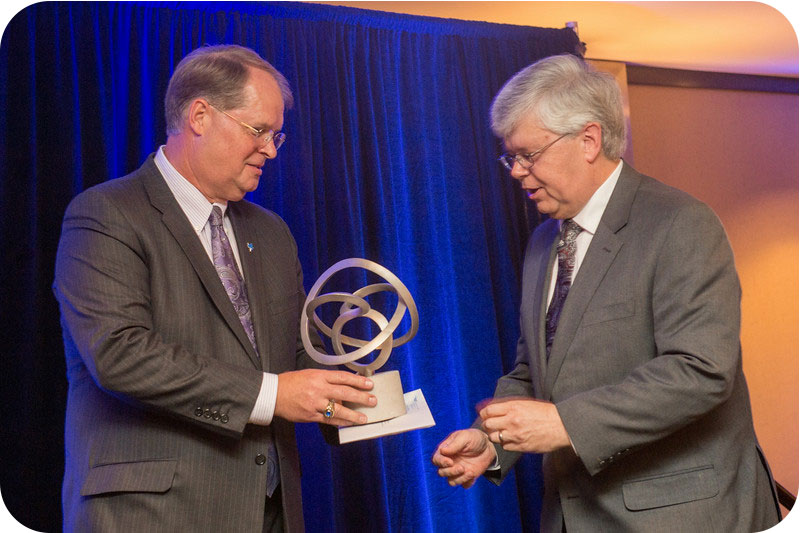 Ron Carpenter (left), Indiana State University Foundation President, presents the 2014 March On! Corporate and Foundation Award to Tom Rocklin, manager of Midwest communications for Siemens PLC, in recognition of Simen's in kind gift of $9.7 million in so