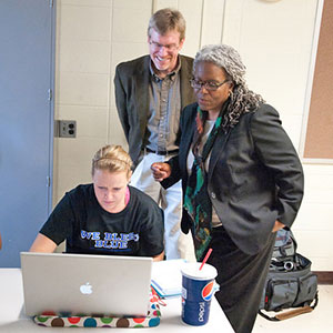 Ken Jones and IUPUI professor Peggy Daniels Lee help Candace Greubel