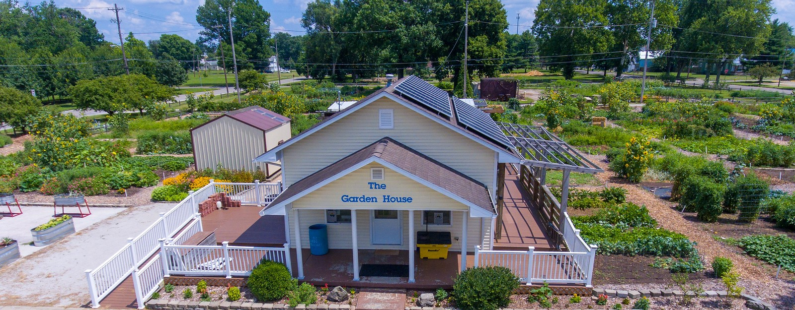 Yellow house with solar panels on the right side of the roof