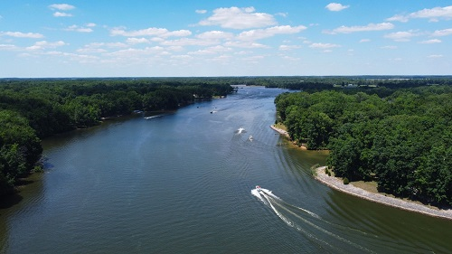 Drone photo of Sullivan lake with trees around the edges