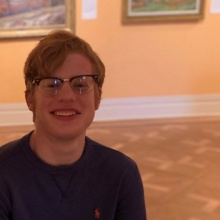 Christian in front of a painting