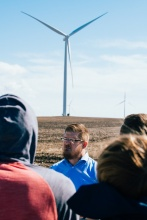 speer in front of a wind turbine teaching students